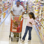 Father and daughter grocery shopping in grocery store